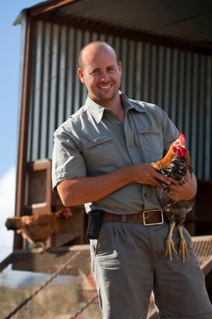 Waterkloof Farm Manager Christiaan Loots with chickens 1 LR